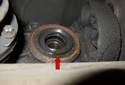 This photo shows the drive axle seal (red arrow).