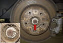Remove the center cap on the rear wheel of vehicle.