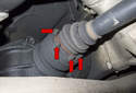 Next, you have to loosen the six axle-mounting bolts (red arrows).