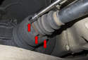 This photo shows loosening the drive axle bolts (red arrows) using an E12 socket with a six-inch extension and a flex-head ratchet.
