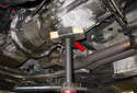 Place a screw jack or hydraulic jack under the transmission (red arrow).