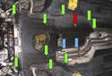 Removing the transmission splash shield: Working under the vehicle, using an 8mm socket or nut driver, remove the two splash shield fasteners (blue arrows).