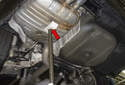 Place a screw jack or hydraulic jack under the rear muffler (red arrow).