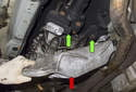 With the cross member fasteners removed, pull the cross member (red arrow) down and away from the transmission.
