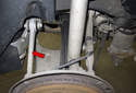 The traction strut is the forward most upper rear control arm (red arrow).