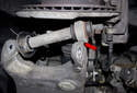 This photo shows the alignment of the control arm and wheel-bearing carrier from below.