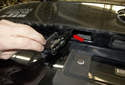 License Plate Bulbs and Lens: Pull the lens out of the trunk, while feeding the wiring harness out (red arrow).