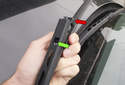 Wiper blade replacing: To install a new wiper blade, feed the tab on the wiper blade (green arrow) into the wiper arm.