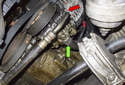 Working under your vehicle at the front corner, use a 19 mm wrench to remove the PS pump high-pressure line (red arrow).