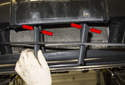 Unclip the retaining clips (red arrow) and pull the top of the grille out of the bumper, then angle it as you remove it and pull the bottom of the grille out.