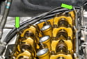 Remove the studs at rear of cylinder head using a 10mm deep socket (green arrows).
