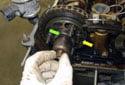 Slide the exhaust camshaft splined shaft into the camshaft sprocket.