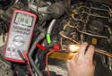 Working at the front of the cylinder head, I found the wiring harness that came up from the coolant pump.