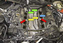 With the intake manifold removed you can now remove the intake manifold gaskets (green arrows).