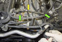 Next, the small coolant hose (yellow arrow) has to be removed.