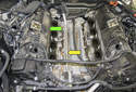 Next, remove the 10mm coolant pipe fastener (green arrow).