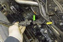 Once the purge solenoid is removed from the bracket, detach the lower hose (yellow arrow) by squeezing the collar while pulling the hose off the valve.
