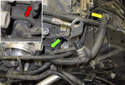 The breather hose (yellow arrow) looks like it could stay attached during removal.