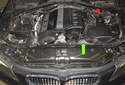 The alternator on BMW E60 models with a M54 6-cylinder engine is located on the left side of the engine (green arrow).