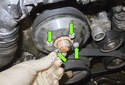 Now you can remove the four 10mm water pump pulley fasteners (green arrows).