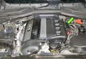 The DISA valve is located on the left side of the intake manifold, in the center (green arrow).