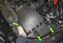 Next, unclip the three air filter lid clips (green arrows).