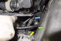 Intake camshaft sensor: The camshaft sensor electrical connector (blue arrow) is located at the electrical junction behind the alternator (yellow arrow).