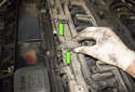 Working at the fuel rail, remove the oxygen sensor connector mounts (green arrows) by squeezing and pulling them toward the left side of the engine.