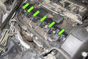 BMW E60 models equipped with a 6-cylinder engine utilize an individual ignition coil for each spark plug, referred to as coil over plug (green arrows).