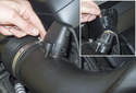 8-cylinder: Working at the mass air flow sensor, unclip the electrical connector plastic cover.