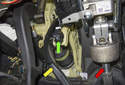 Working at the front of the brake pedal, disconnect the brake light switch electrical connector by pulling the connector straight up and out the brake light switch (green arrow).