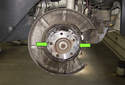 Using a long 5mm Allen bit, remove the parking brake shoe retaining clips by rotating it 90° and pulling it away from the brake shoes.