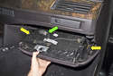 Once the screws are removed, pull the glove box down and away from the dashboard.