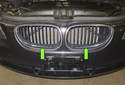 The radiator grilles consist of two grilles (green arrows) mounted in the radiator support above the front bumper cover.