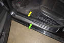 The doorsill is trimmed by two separate pieces -- one covering the inner doorsill (yellow arrow) and one covering the outer doorsill (green arrow).