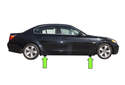 BMW E60 models have 4 solid plastic jacking pads, slightly behind the front wheels and slightly in front of the rear wheels (green arrows).