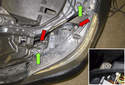 Headlight assembly: Working at the top of the headlight, remove the two T30 Torx fasteners (green arrows).