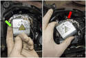 Headlight assembly: Flip the locking spring (green arrow) off the headlight.