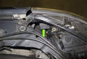 Turn Signal Bulb: The turn signal bulb (green arrow) is located in the headlight assembly, near the connection to the front fender.