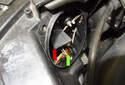 Front Driving Light: Rotate the high beam bulb holder (red arrow) 45° and remove it from the headlight.