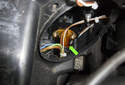 Front Driving Light: Rotate the halo bulb (green arrow) 45° and remove it from the headlight.