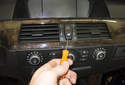 Hazard Light / Door Lock Switch: Using a small flathead screwdriver, gently lever out the switch.