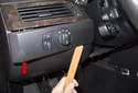 Headlight Switch: Using a plastic prying tool, gently lever out the headlight switch with the trim prying tool.
