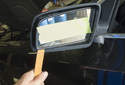 Mirror glass: Using a plastic prying tool, gently lever out the mirror glass.