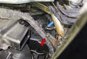 Left Dashboard Vent: Working in the left side footwell, detach the wiring harness from the mount (red arrow).