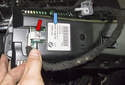 Pull the left side electrical connector (red arrow) straight out of the display.