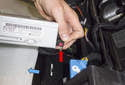 Radio: Then pull the antenna connection (red arrow) straight off the radio to disconnect it.