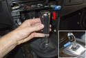 Next, remove the shift knob by pulling it straight up and off the shift lever (red arrow).