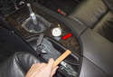 Using a plastic prying tool, gently lever up the rear of the center console trim.