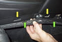 The yellow arrows point to the carpet trim panel mounting holes.